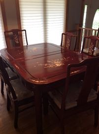 Incredible Chinese Rosewood Table with leaves, 6 chairs. Mother of Pearl Inlaid Design.  Custom designed cushions