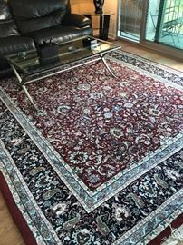 Red with blue and cream Oriental rug. Thick and plush. Open field. 9' X 12'. In Excellent shape. No pets or smokers. $500