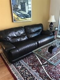"""Dark brown leather sofa with pebble texture and top stitching. Two sections recline automatically. 87"""" long X 38"""" deep. In good condition. $400"""