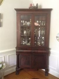 Antique corner cabinet with claw feet.
