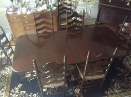 Top view of dining room table. Great condition. Extra leaves stored in front closet.