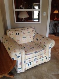 Garden room chair has matching room divider and sofa.