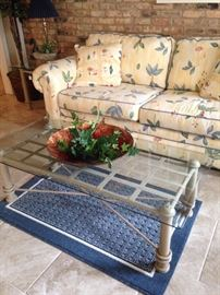 Garden room sofa has matching room divider and chair; glass top coffee table has a matching end table.
