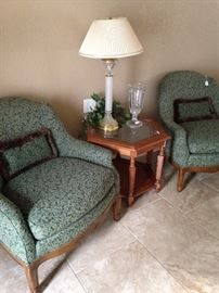 Good-looking matching green upholstered chairs; one of the several lamps