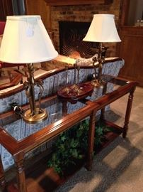 Two tiered glass top sofa table; pair of lamps