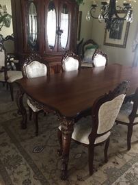 Dinning table with chairs and matching hutch