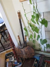 African musical instruments surrounded by books relevant to today's interests - environmental and etc.