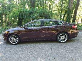 2013 Ford Fusion fully loaded.  Very low milage.