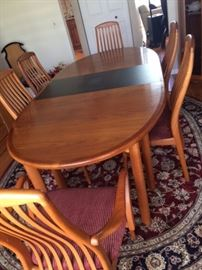 Danish Dining Room Table Teak Wood with 2 leaves and 6 chairs