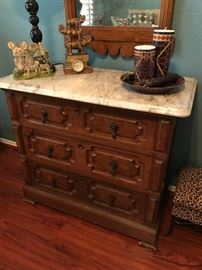 Really fine antique chest with marble top. Antique mirror, knickknacks not available