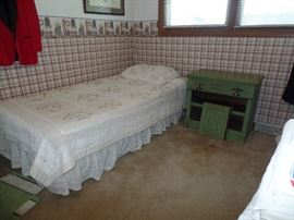 Twin bed and vintage green cabinet