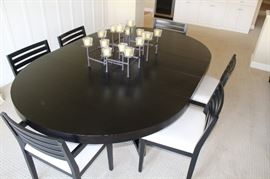 """With two extensions, the table is 7 feet long. Each extension is 15""""."""