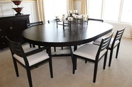 """With two extensions; table is 7 feet long and is 5 feet wide. Each extension is 15"""" long."""