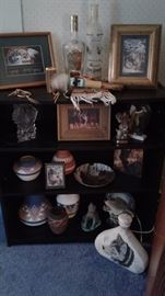 Native American pottery, wolf items and pictures.  4 shelf black bookcase (2)