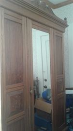 Very large oak wardrobe.  With mirror and large bottom drawer. Bought at Sandwich Antique Fair