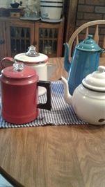 Antique coffee and tea pots.  Enamel