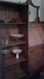 Antique oak hutch.  4 shelves, glass door ( not shown in picture) Mirror Drawer (1) Cabinet ( 1) Fold down area