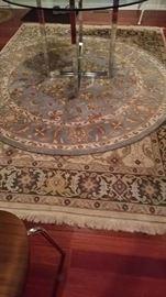 2 Rugs-1 circular 1 Persian
