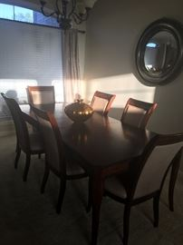 Beautiful Dining Table with taupe leather chairs.