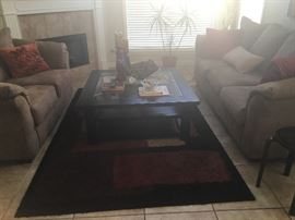 Beautiful living room furniture, table s and rug.