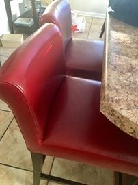 Red leather bar stools.
