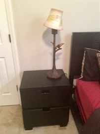 Nightstand and lamp.