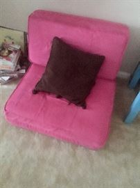 Girls lay out chair and bed.