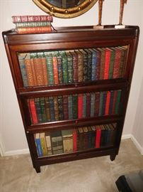 Antique Weis stacking bookcase with many leather bound books