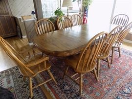 Very large dining table with leaves, 8 chairs. $350