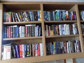 Hundreds of books, Jean Saul, David Baldacci, Erma Bombeck, Clive Cussler, Ken Follett, Robert Ludlum, Tom Clancy,religious books, human interest, biographies, medicine and health, political, many more authors.