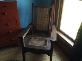 Unique Morris Plantation chair with arm extensions. Legs were rested up on those extensions for relaxation. Oak, seat needs caning.
