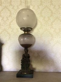 Lovely oil lamp with cast lady base. Beautiful etched, original glass.