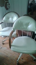 LOVE THESE CHAIRS. They swivel and roll!