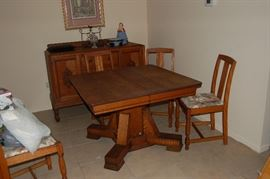 Dining table and sideboard.  Four chairs.