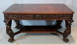 24 -  Large R,J. Horner library table with atlas figures, 31 in. T, 36 in. W, 60 in. L.