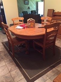 kitchen table -- sturdy with 2 leaves & 6 side chairs