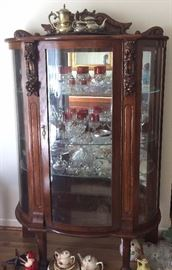 Antique curved glass china cabinet, cut to clear cranberry glass, tea service