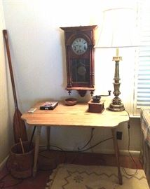 Drop leaf table, lamp, antique coffee grinder, antique wall clock, butter churn bucket, oar