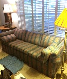 Plaid sofa, brass floor lamp