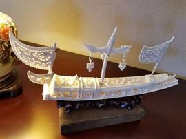 Ivory carving ship, on wood stand.