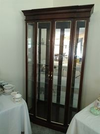 Lighted Hutch in excellent condition. Shelving is etched for plates. $595