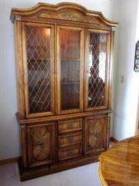 """High quality (Stanley Furniture), solid wood china cabinet with glass shelves, lighted, brass lattice inserts and hardware, lots of bottom storage.  52"""" wide, 83"""" tall, 15-1/2"""" deep."""