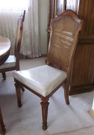 """High quality (Stanley Furniture), solid wood dining table with two leaves and full set of pads. 42"""" wide, 62"""" long, opens to 94"""" with leaves.  Six chairs with tall caned backs and padded seats.  In great condition!"""