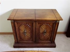 """High quality (Stanley Furniture), solid wood buffet server.  Top flips open for additional serving space.  One drawer, storage behind double doors.  37"""" wide, 19"""" deep, 30"""" tall.  Top opens to 59""""."""