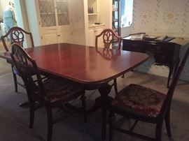 Duncan Phyfe style mahogany table with 2 leaves and 6 chairs