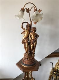 Figural Goldleafed Lamp with Satin Glass Shades.