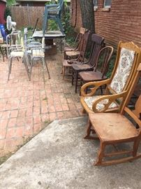Numerous wooden chairs