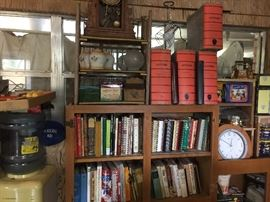 Water cooler. Cookbooks, clock, old ledger/document boxes, 50s yellow and chrome canisters.