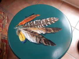 small hand painted stool, done by a local artist
