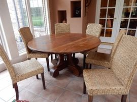 Natural Wood Pedestal Table with 6 glorious rattan and wood chairs. by  Mig and Tig